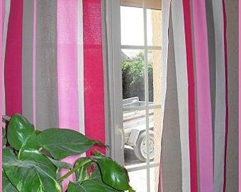 GORGEOUS CURTAINS package has pink stripes.