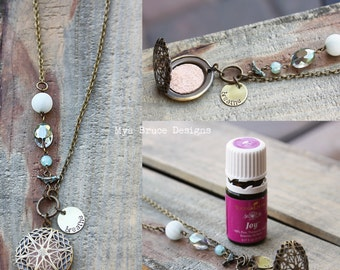 DIFFUSER necklace -  long antiqued gold design with jewels and bird worked into the chain, with breathe pendant