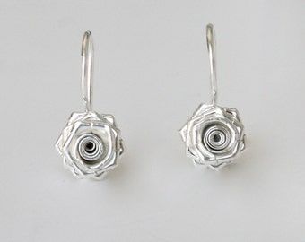 Pretty & petite rose earrings feature a delicate design in sterling silver. Beautiful handcrafted Petals 'LOVE ROSE' earrings