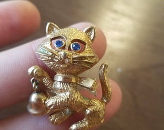 Lovely Vintage Avon, Whimsical Kitty Cat Brooch with Blue rhinestone eyes, and a little bell