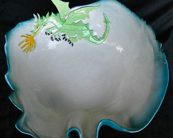 Large decorative ceramic Dragon Bowl with ruffled edge.