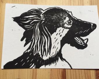 Linocut dog postcard