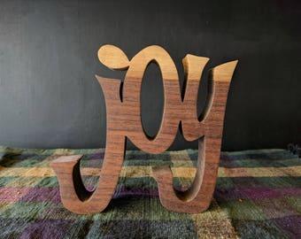 "Inspirational wooden words ""JOY"""