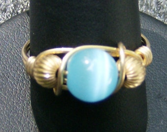 Wire Wrapped Ring - Handmade, Robin's Egg Blue Cat's Eye with Gold, Corrugated Gold Beads, Size 10 by JewelryArtistry - R309