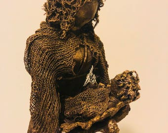 A Woman and Child Statue