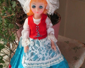 Swiss Miss, 15 inch blonde dress up doll in handmade outfit.