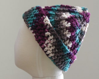 Child's crocheted hat, plum,teal,cocoa,and cream variegated yarn. S (T1-T2)