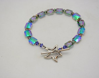 Half Off Swarovski Bracelet in Crystal Paradise Shine w/ Pewter Star Clasp. Reflects lavender, green, & pink. Unique handmade jewelry.