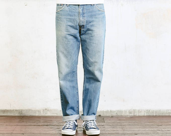 Levis 521 02  Distressed Men Jeans . Vintage Levis Strauss Light Blue Worn In Ripped Faded Denim Pants Trousers 90s Jeans . size W36 L30
