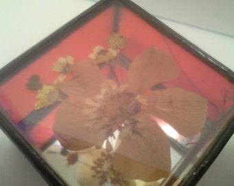 Red glass box with flower design