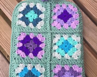 crochet covered hot water bottle