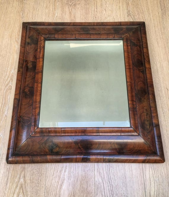 Late 17th century antique William and Mary oyster veneered laburnum cushion framed mirror with later bevelled plate