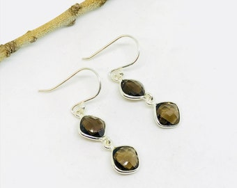 Smokey topaz earrings set in sterling sliver 92.5. Perfectly matched Natural smokey topaz stones. Length-1.20 inch long.