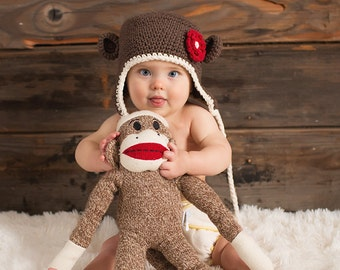 Newborn to 12-24 months brown monkey beanie with earflaps and a red flower