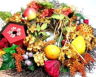 Wreath With Red Bird House And Fruit