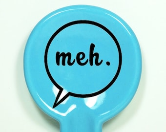 spoon rest shown here in cloudless blue with the word bubble 'meh'.   Made to Order / Pick Your Colour