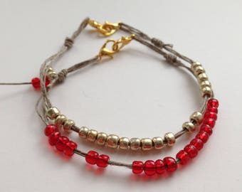 set of 2 bracelets of glass and delicate red and gold hand made textile