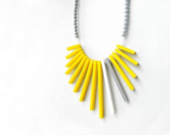 geometrical tribal necklace with yellow, grey and white sticks and grey beads , contemporary jewelry
