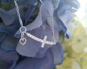 Cross Bracelet ~ Sterling silver CZ cross.