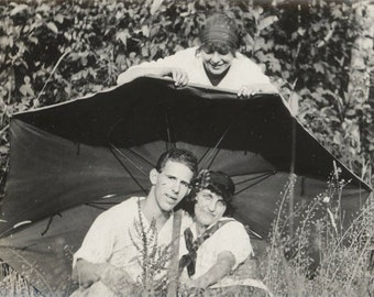 """vintage photo Young Lady Peeks Over Couple Under Umbrella to """"Rain"""" on their Parade 1922"""