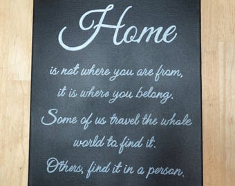 """Canvas: """"Home is not where you are from, it is where you belong. Some of us travel the whole world to find it, others find it in a person"""""""