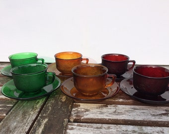 Colorful set of heads and saucers-Arcoroc
