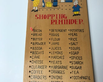 Vintage teak shopping reminder board with removable pegs.