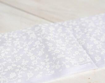 White little flowers on white cotton