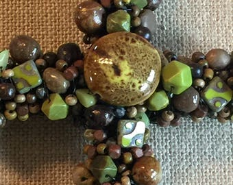 Beautiful, handcrafted unique decorative beaded cross, tones of green and brown. Perfect hostess ir thank you gift.