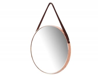 Mirror hanging on a copper bar