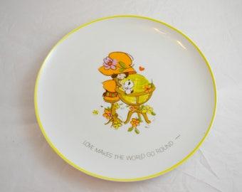 "Mopsie ""Love Makes the World Go Round"" Plate"