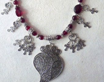 Dark red and silver hearts and crosses necklace