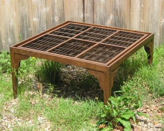 Custom handmade walnut wood coffee table, with a collection table top made from printers type boxes
