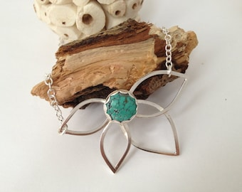 Sterling silver flower pendant with 12mm round Tibetan spidersweb turquoise