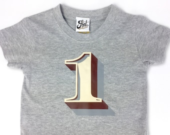 First Birthday Kids T-shirt- One Shirt- Boys & Girls Tee- 1st year baby! Age Party outfit. Uk seller. Number 1. Stirling Shadow Type