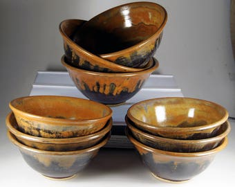 Medium stoneware bowls suitable for rice noodle or deserts .