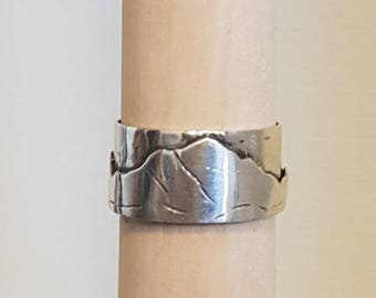 Silver ring with mountains