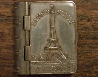vintage silvered booklet wit pictures of tour the eiffel tower in Paris France