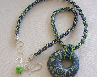 Blue, Lime & White Hollow Donut Pendant with Kumihimo Rope Necklace by Carol Wilson of PollyClayDesigns