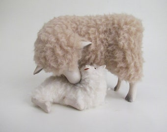 Leicester Longwool Ewe Cheek to Cheek with Lying Lamb
