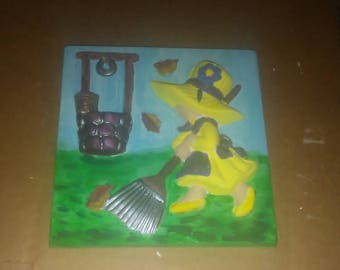 painted girl with rake plaster relief wall decor