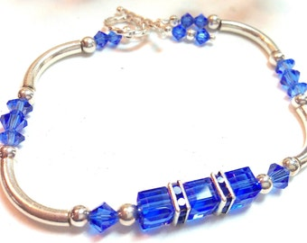 Sapphire Blue Swarovski crystal and sterling silver bracelet and earrings set