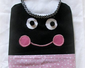 Pink and black bib with funny face