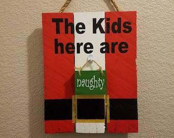 The kids here are NAUGHTY / NICE - christmas sign