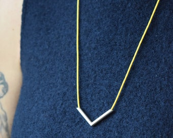 Sterling silver chevron necklace in yellow.