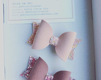 Soft faux suede and chunky glitter dolly bow