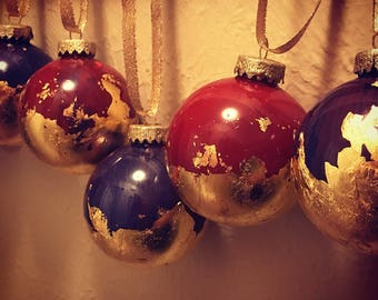 Hand painted gold leaf ornaments marbled in Tuscan Red and Royal Purple