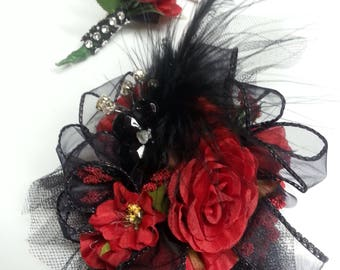 Wrist corsage and matching boutonnière set made with realistic-looking red roses.