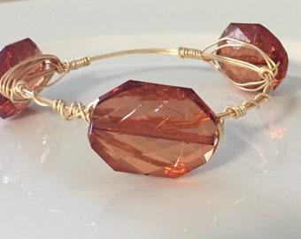 Brown acrylic bead wire bangle bracelet