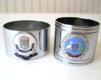 2 New Zealand Napkin Holders/ Rings with crests of N.Z. towns. Never been used.